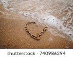 inscription love on the sand of ... | Shutterstock . vector #740986294