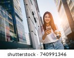 young woman with coffee to go... | Shutterstock . vector #740991346
