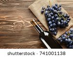 fresh ripe grapes and bottle of ... | Shutterstock . vector #741001138