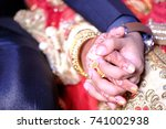 close up of hands of bride and... | Shutterstock . vector #741002938
