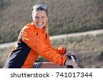 senior woman on country bike... | Shutterstock . vector #741017344