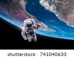 astronaut in outer space over... | Shutterstock . vector #741040633