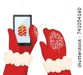 hands holds a smart phone ... | Shutterstock .eps vector #741054160