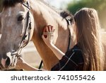 young beautiful female taking... | Shutterstock . vector #741055426