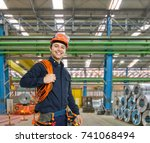 portrait of a smiling engineer... | Shutterstock . vector #741068494
