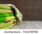 many bath towels. green bath...   Shutterstock . vector #741078958