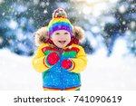 Child Playing With Snow In...