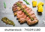sliced medium grilled rib eye... | Shutterstock . vector #741091180