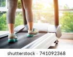 blurry close up on legs of... | Shutterstock . vector #741092368