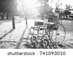Small photo of Empty wheelchair on the garden at sunset. Miracle concept. Healed person raised and went away or hope to heal,black and white tone