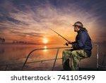 Fisherman Throwing His Rod ...
