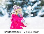 child playing with snow in... | Shutterstock . vector #741117034