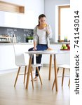 young woman with orange juice... | Shutterstock . vector #741143014