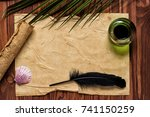 quill pen  inkwell on open... | Shutterstock . vector #741150259