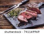 roasted beef steak with salt... | Shutterstock . vector #741169969