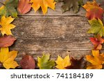 Autumn Leaves Over Wooden...