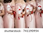 bridesmaid are holding bouquets ... | Shutterstock . vector #741190954