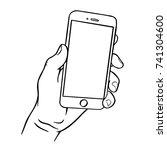 hand holding smartphone. hand... | Shutterstock .eps vector #741304600