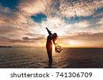 elegant woman dancing on water. ...   Shutterstock . vector #741306709