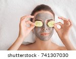 young woman with facial mask... | Shutterstock . vector #741307030