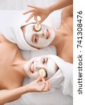 young women with facial masks...   Shutterstock . vector #741308476