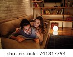 smiling young couple bonding at ... | Shutterstock . vector #741317794