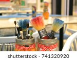 many paint brushes in the jars... | Shutterstock . vector #741320920