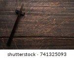 chopsticks on old wooden... | Shutterstock . vector #741325093