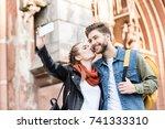 young stylish couple taking