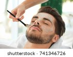 beautician applying scrub onto... | Shutterstock . vector #741346726