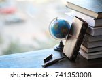 a stack of textbooks on the...   Shutterstock . vector #741353008