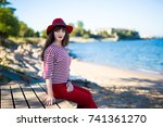 thoughtful woman in red sitting ... | Shutterstock . vector #741361270