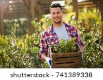 man working in garden center  | Shutterstock . vector #741389338
