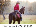 young rider girl on bay horse... | Shutterstock . vector #741421189