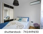 interior of a bedroom in a... | Shutterstock . vector #741449650