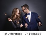 cheerful couple with sparkler...   Shutterstock . vector #741456889