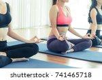 women practicing yoga pose in... | Shutterstock . vector #741465718