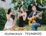 group of friends having party... | Shutterstock . vector #741468430