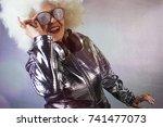 an amazing grandma dj  older...   Shutterstock . vector #741477073