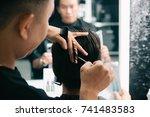 hairdresser cutting hair of... | Shutterstock . vector #741483583