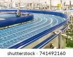 empty conveyor belt of... | Shutterstock . vector #741492160
