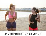 couple of girlfriends jogging... | Shutterstock . vector #741515479