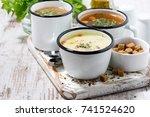 assortment of hot soups in mugs ... | Shutterstock . vector #741524620