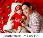 mom lies before her funny... | Shutterstock . vector #741529114