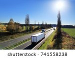 truck transportation at sunset | Shutterstock . vector #741558238