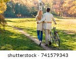 back view of young couple with... | Shutterstock . vector #741579343
