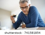middle aged man at home... | Shutterstock . vector #741581854