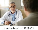 doctor talking to patient in... | Shutterstock . vector #741583993