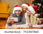 happy little girl in santa's... | Shutterstock . vector #741587860