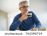 middle aged man at home... | Shutterstock . vector #741590719